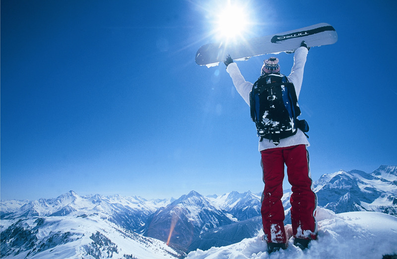 A snowboarder poses for a photo atop Austria's Hintertux.