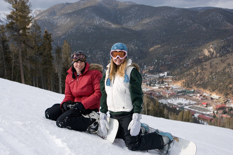 Girl snowboarders at Red River, NM.