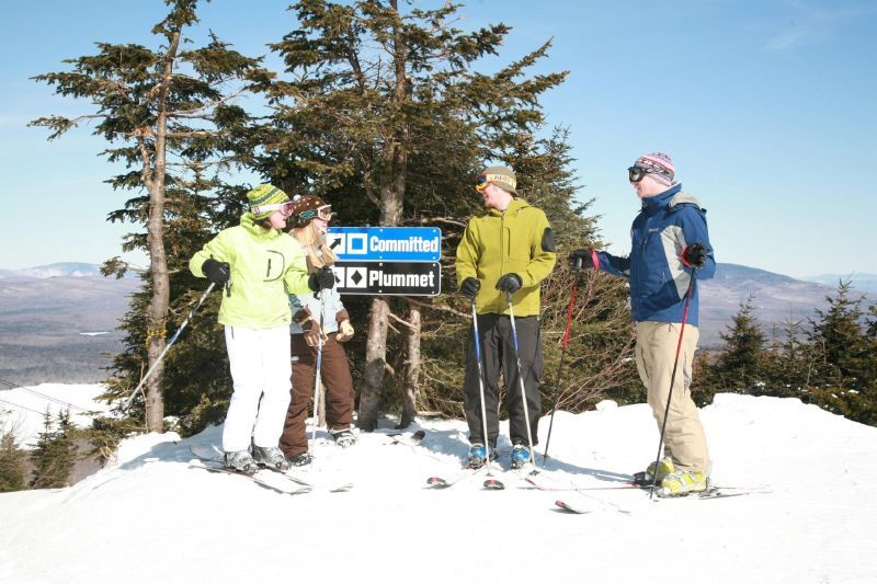 A trio of skiers pause at Mt Snow VT