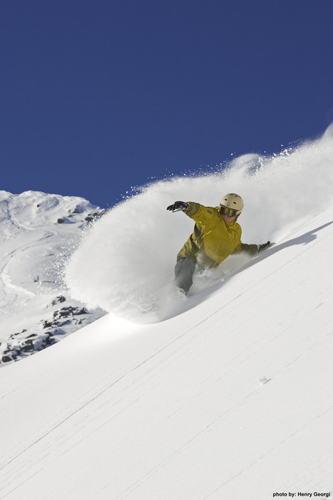 Snowboarder in powder at Lake Louise. Photo courtesy of Lake Louise.