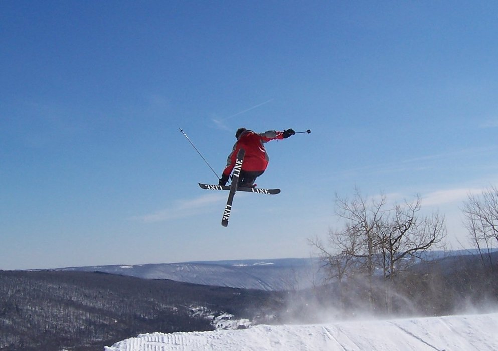 Skier over the terrain park at Bristol Mtn, NY