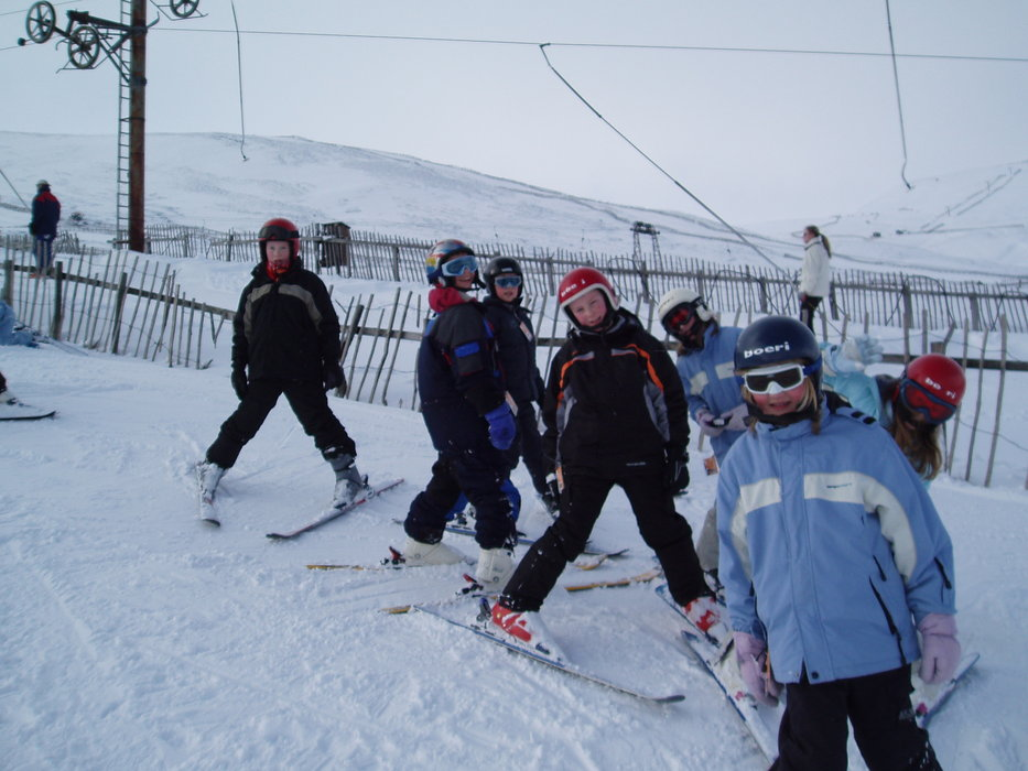 Skiers awaiting a drag lift up at Glenshee, Scotland. Copyright: Cairnwell Mountain Sports