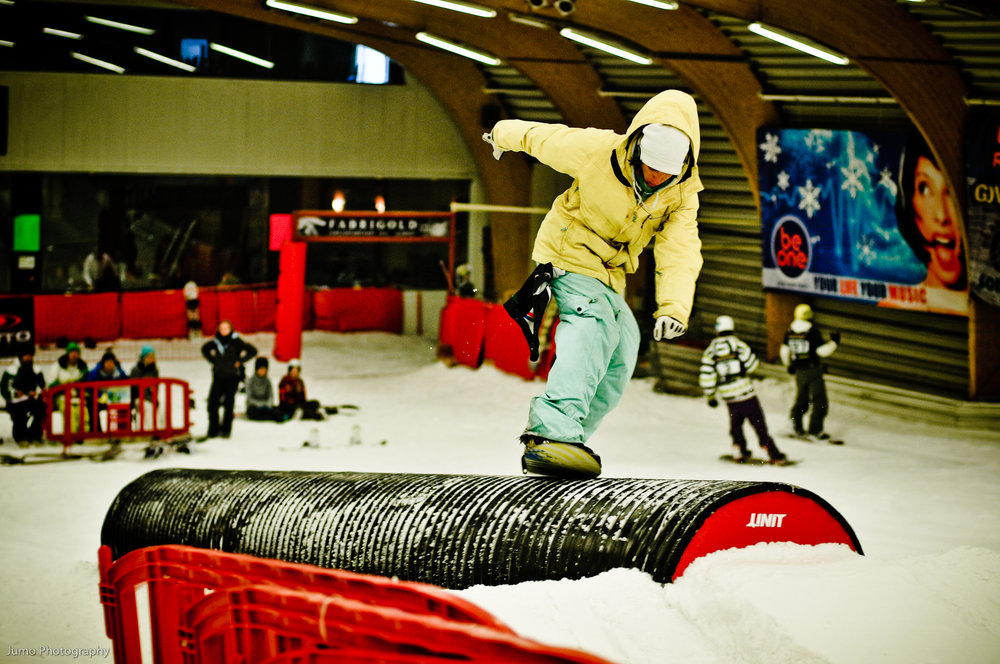 Freestyle boarder on a barrel element at the Ice Mountain, Belgium terrain park.