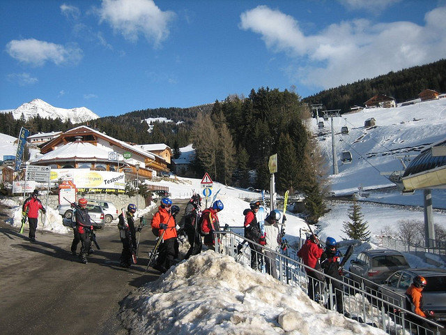 Skiers at the parking lot at Meransen, Italy