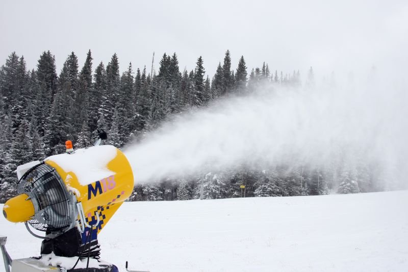 A snowmaking machine in Breckenridge, Colorado shoots off new snow