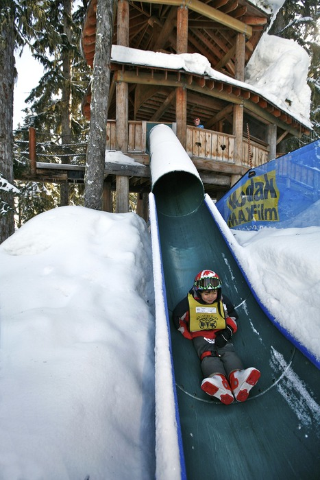 A child slides down the Tree Fort slide on slide on Whistler Mountain. Photo by Toshi Kawano, photo courtesy of Tourism Whistler.