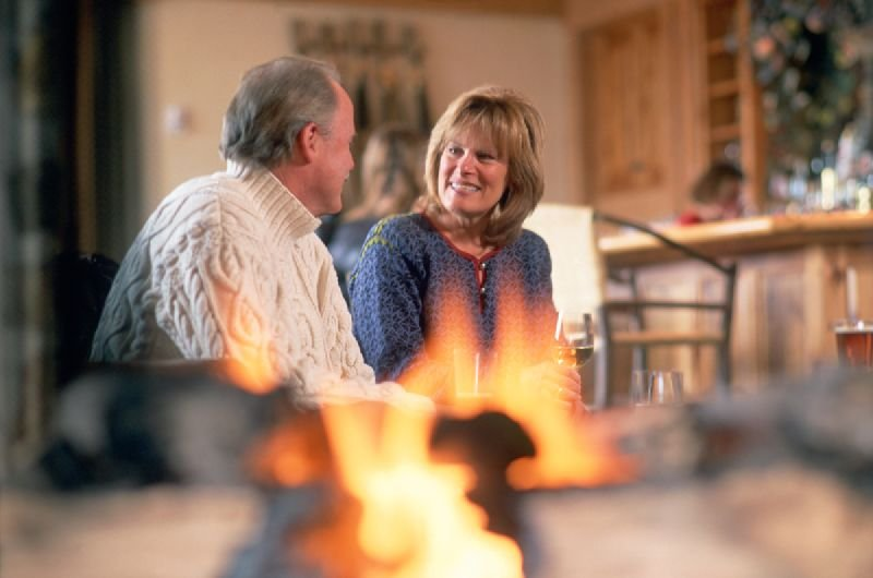 Couple sitting fireside at a lodge in Telluride, Colorado