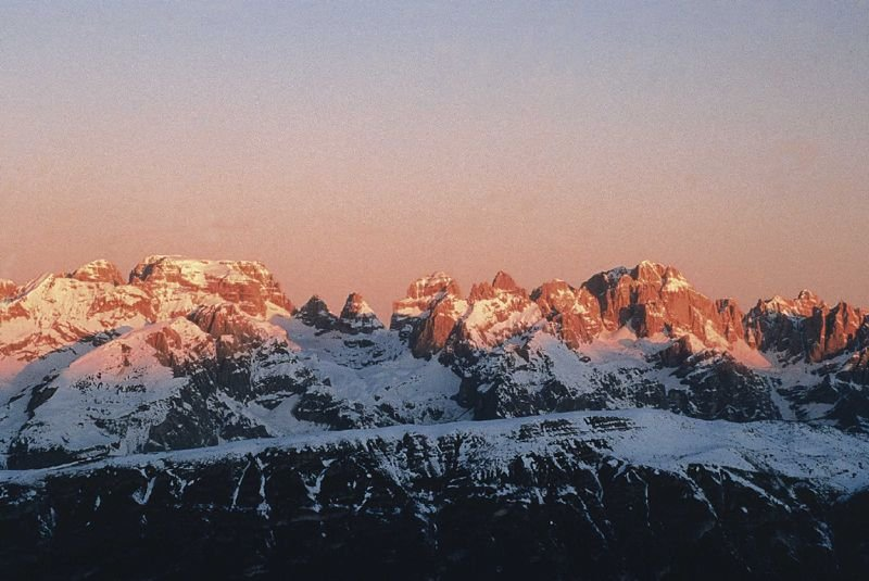 Sunset over snow-covered Andalo mountains