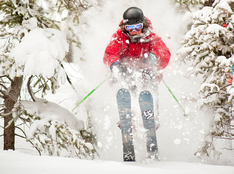 A skier rips through Sun Valley powder. Photo courtesy of Visit Sun Valley.