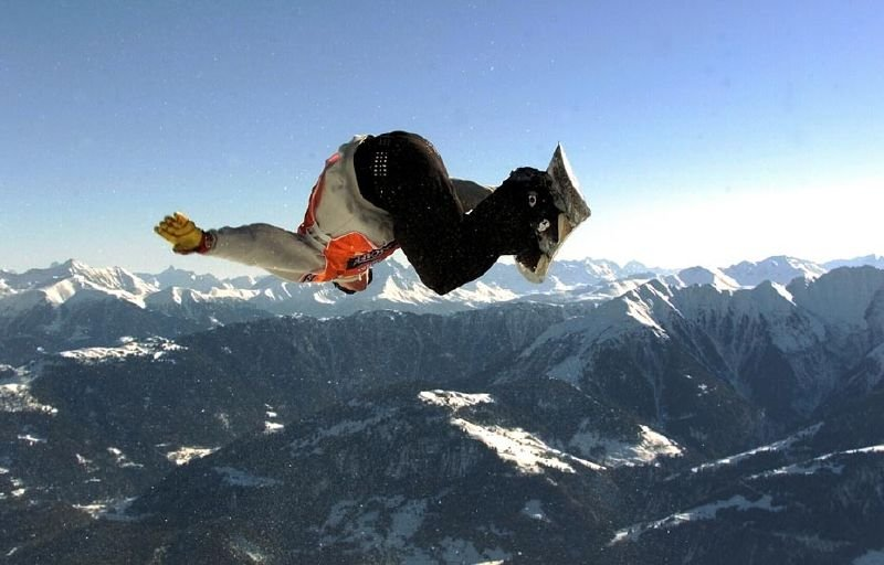 A snowboarder over the slopes of Laax.