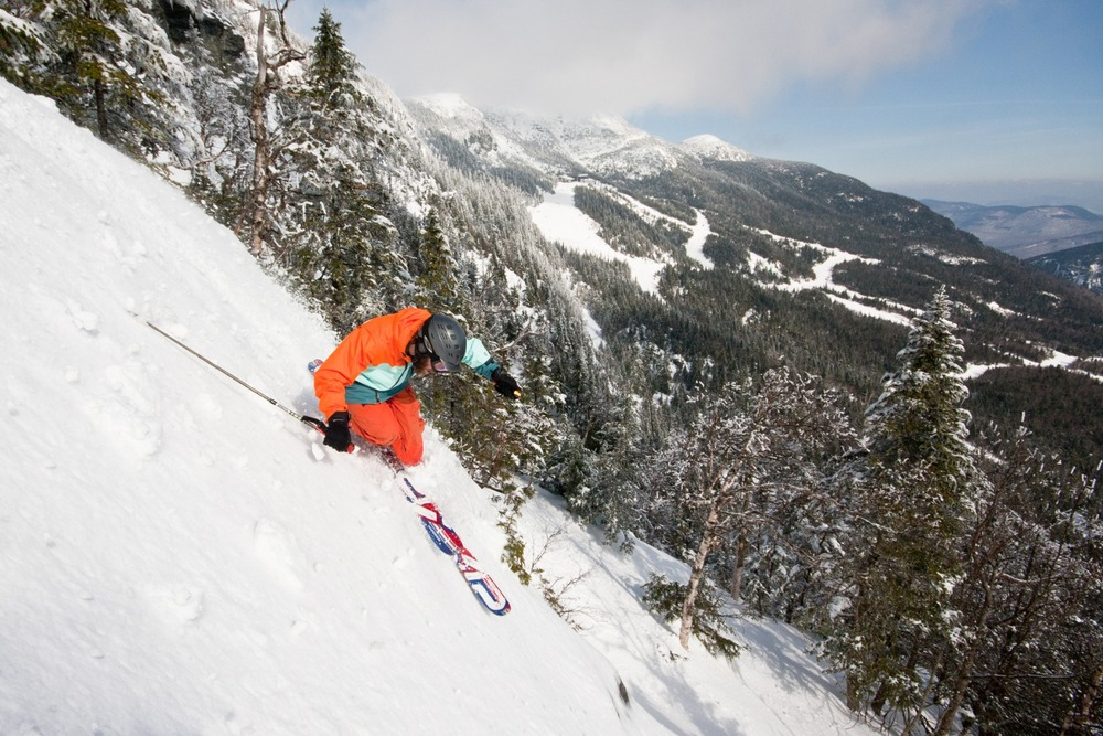 A skier makes steep turns above the tree line on Mount Mansfield. Photo Courtesy of Stowe Mountain Resort.