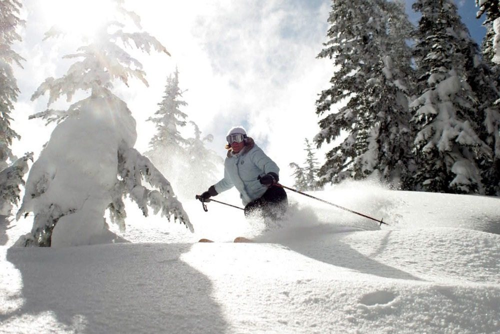 A skier in powder at Mission Ridge. Photo courtesy of Mission Ridge.