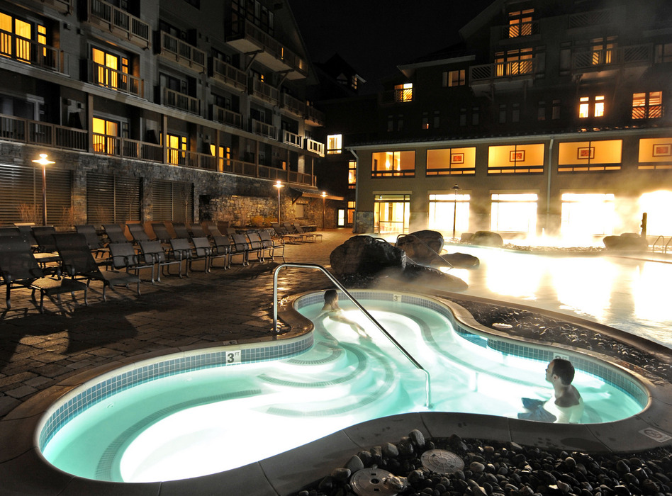 Indoor/outdoor heated pool and hot tubs are open nightly until 10pm. Photo Courtesy of Stowe Mountain Lodge.