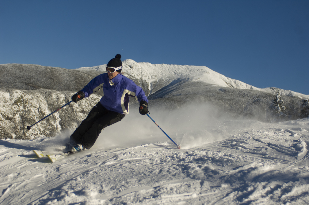A skier enjoys fresh snow at Cannon Mountain. Photo Courtesy of Cannon Mountain.