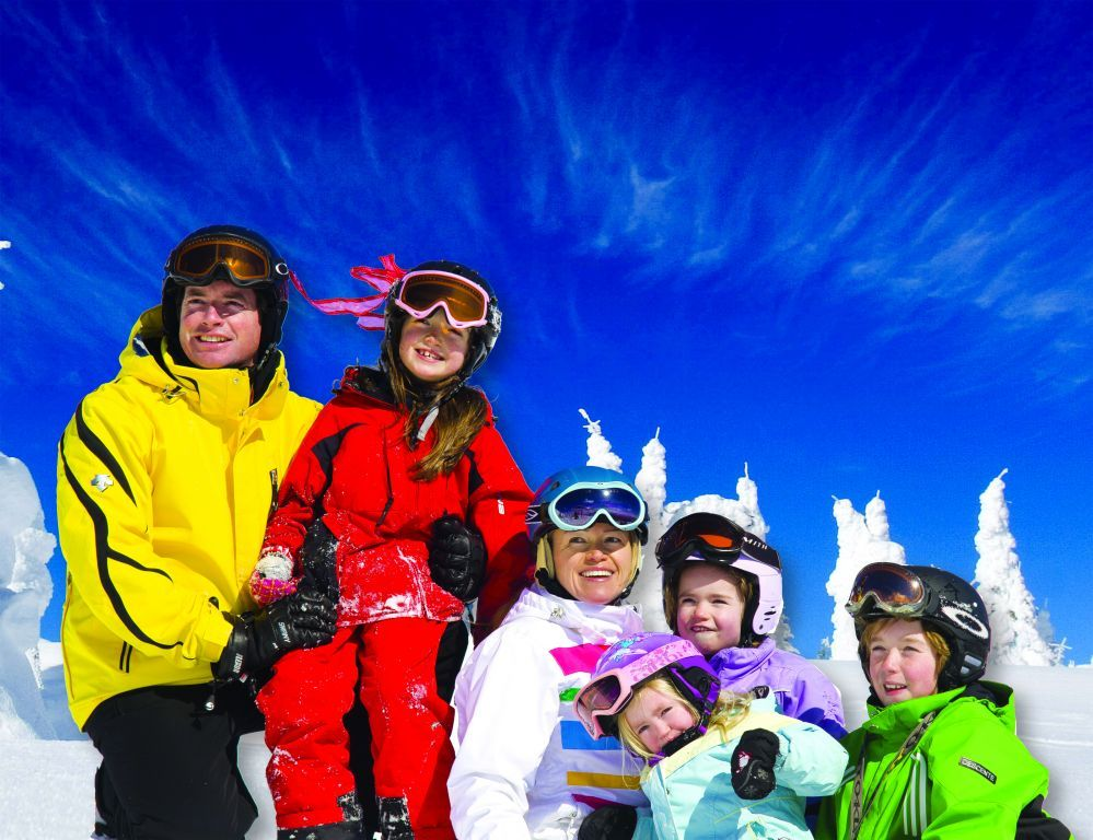 A family of six at Big White. Photo by Matt Butterworth, courtesy of Big White Ski Resort.