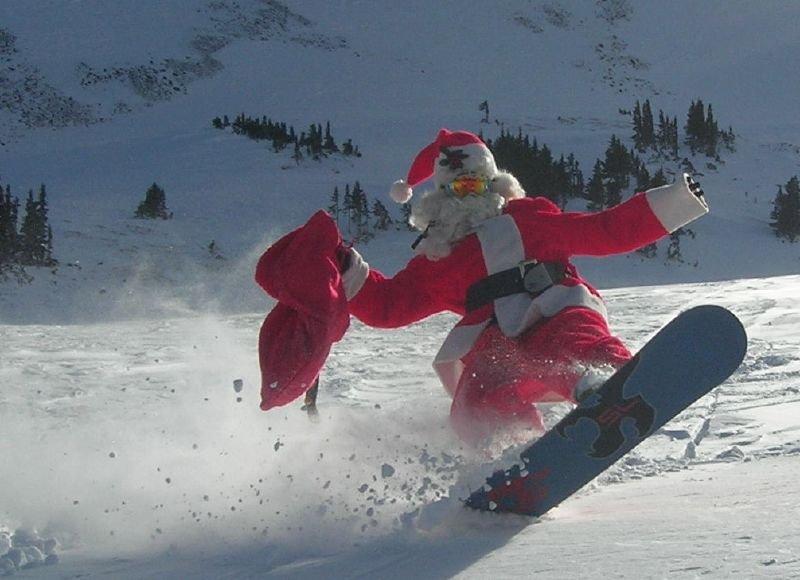 A snowboarding Santa at Loveland.