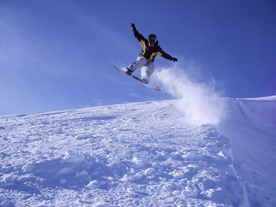 A snowboarder enjoys hang time at Mt. Bachelor. Photo by Danny/Flickr.