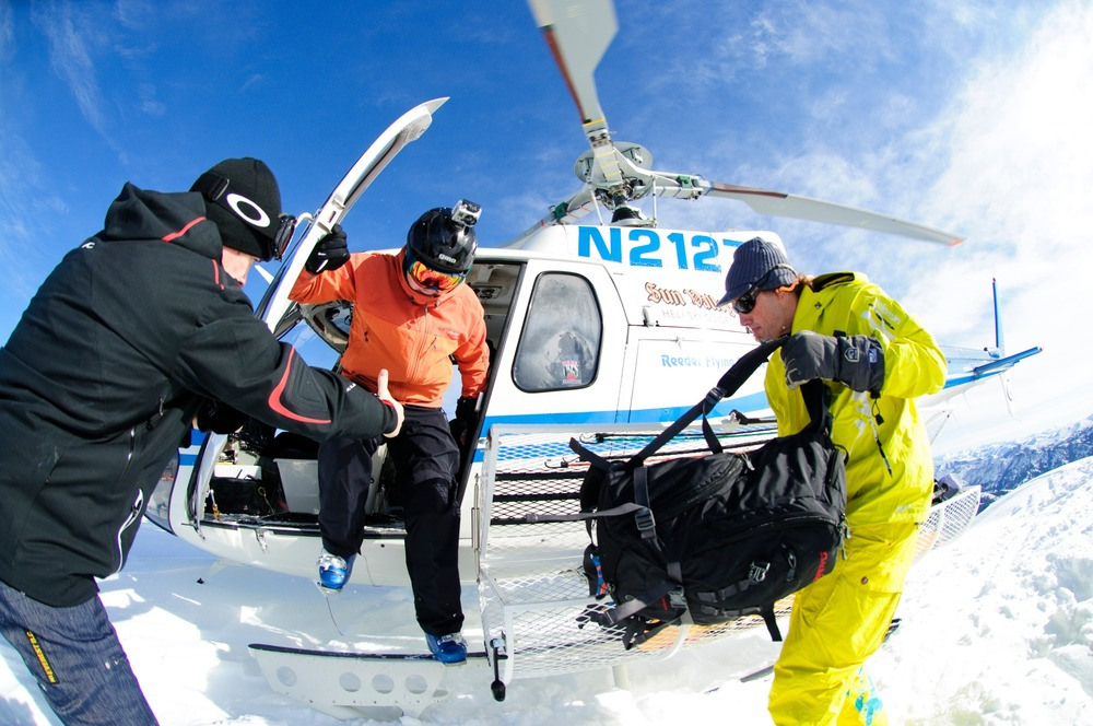 Editor Dan Kasper hopping out of the chopper with Sun Valley Heli-Ski Guides.