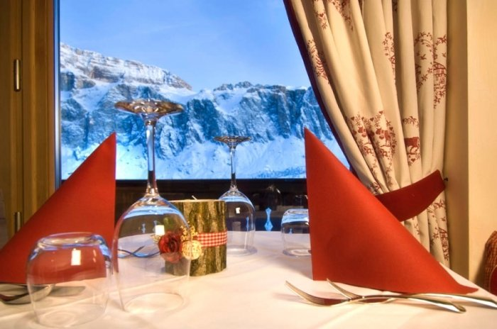 Dinner next to the Dolomites at Almhotel Piz Seteur, Val Gardena