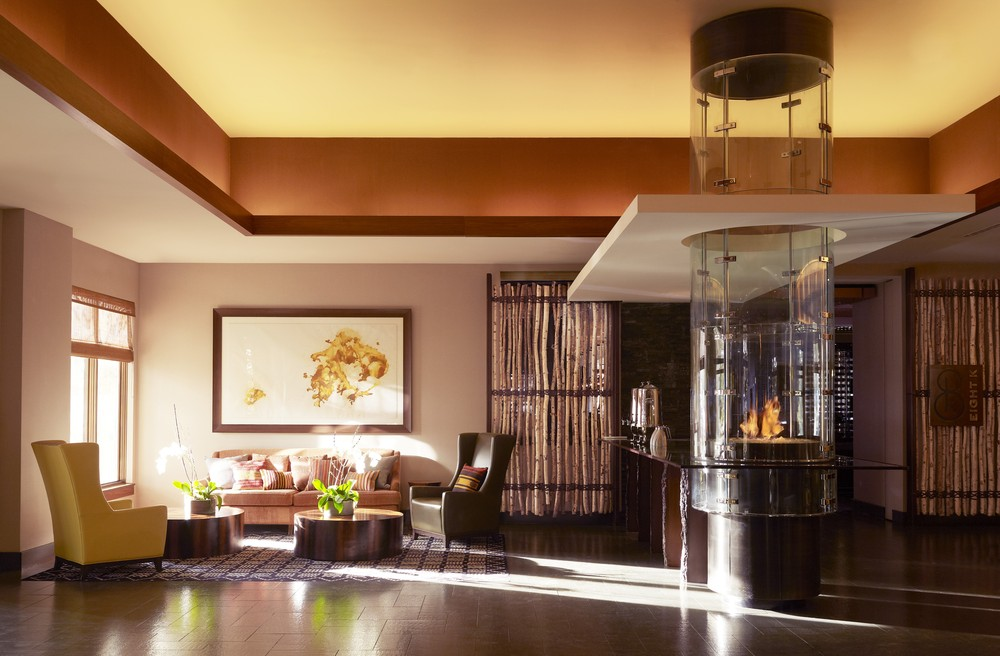 Architect Jean-Michel Gathy used design features like the cylindrical, glass-enclosed fireplace in the lobby to give Viceroy Snowmass an organic mountain aesthetic.