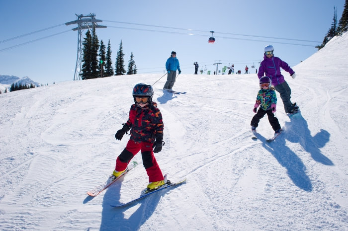 A family skis together on Whistler Mountain. Photo by Mike Crane, courtesy of Tourism Whistler.