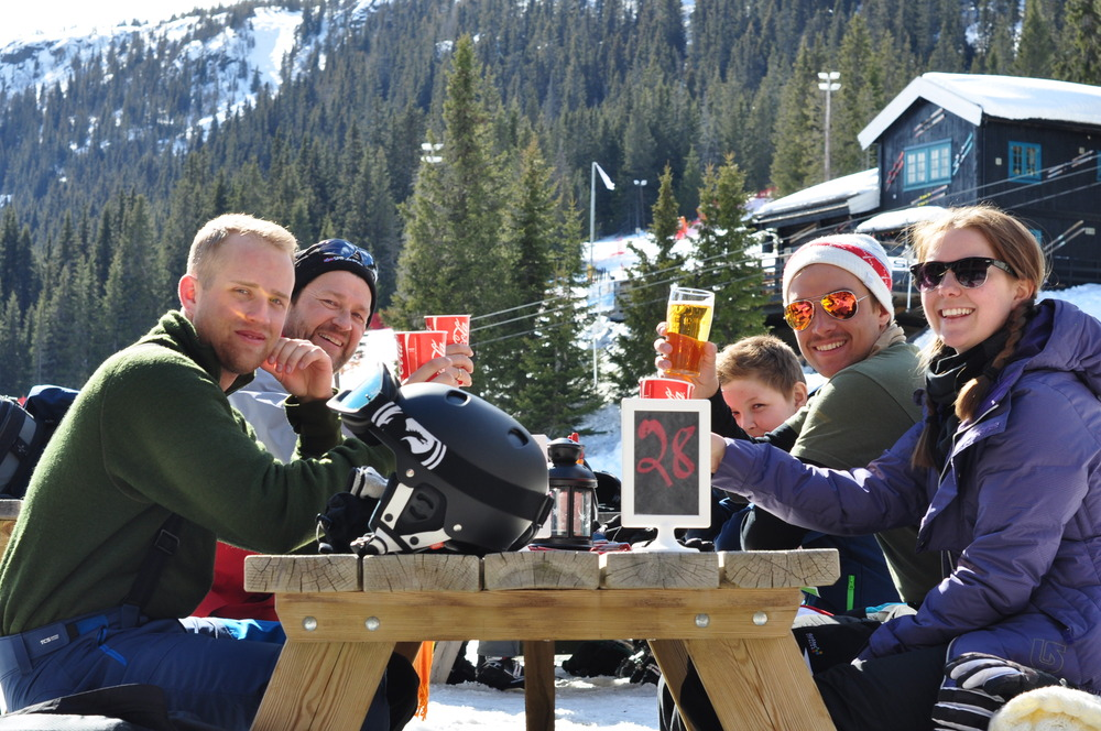 Johansson family from Sweden enjoy drinks in a Kvitfjell slopeside restaurant.