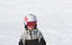 Young snowboarder cruises down a run at Boyne Mountain Resort, Michigan