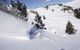 A skier sinks into powder at Grandvalira Andorra