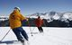 Skiers cruise down a run in Winter Park, Colorado