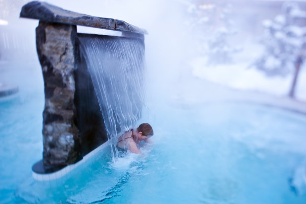 Soaking in an outdoor hot pool at Scandinave Spa at Whistler. - ©Tourism Whistler