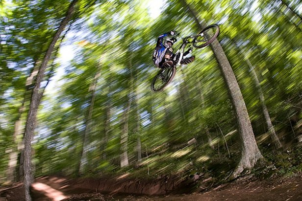 The West Virginia wilderness provides ample opportunities for catching air in Snowshoe.  - ©Philip Duncan