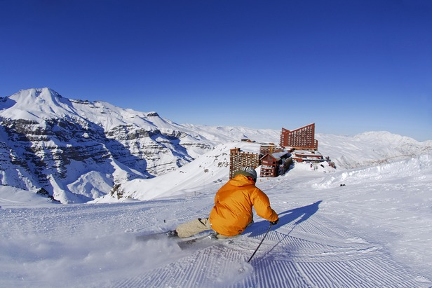 Skier on a groomed slope at Valle Nevado, Chile.