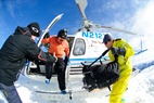 Editor Dan Kasper hopping out of the chopper with Sun Valley Heli-Ski Guides. - Editor Dan Kasper hopping
