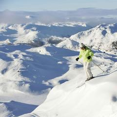 Skiers pausing before descent at Hemsedal, Norway