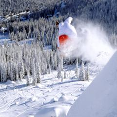 Skier catches air at Schweitzer Mountain.
