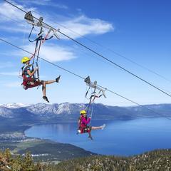 Two brave souls take a spin on Heavenly's Blue Streak Zip Line. - ©Heavenly Mountain Resort