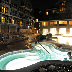 Indoor/outdoor heated pool and hot tubs are open nightly until 10pm. - ©Stowe Mountain Lodge