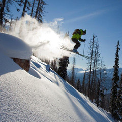 Catching air at CMH-Heli Skiing