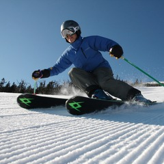 A skier rips through fresh corduroy at Sugarloaf. Photo Courtesy of Sugarloaf.
