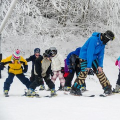 A  group of beginner skiers learn how to make the snow plow. Photo Courtesy of Ski Beech.