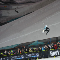 Shaun White explodes out of the superpipe Sunday night.