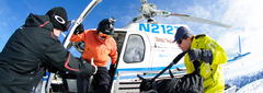 Senior managing editor Dan Kasper jumps out of the heli at Sun Valley.