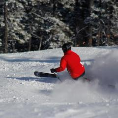 A skier gets some soft turns on Superbowl Sunday, February 3, 2013. Photo Courtesy of Sunday River, Facebook.