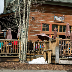 Thirsty skiers and snowboarders take in some sun on the deck at the Kickapoo Tavern in Keystone.