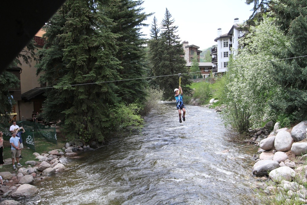 A young adventurer Eddie Bauer set up a free zipline across Gore Creek. - © Tim Shisler