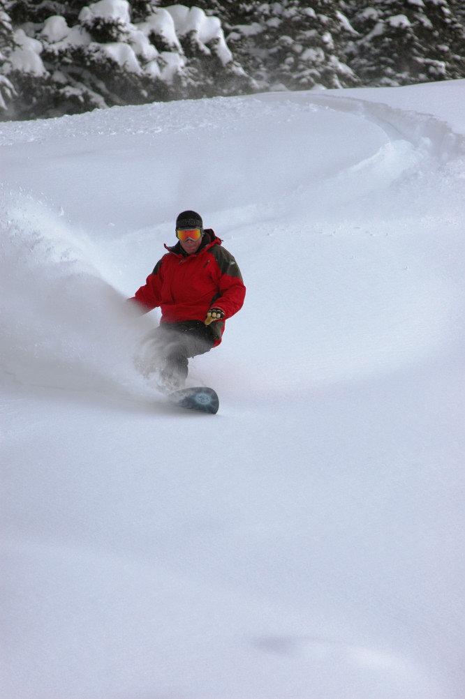Ethan Mueller snowboards in new powder at Creste Butte, Colorado