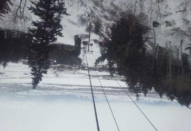 top of Bridget gondola has flurries but weather is fantastic