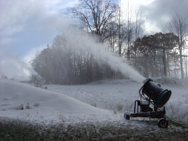 Snowmaking machines shoot snow onto runs in Caberfae Peaks, Michigan