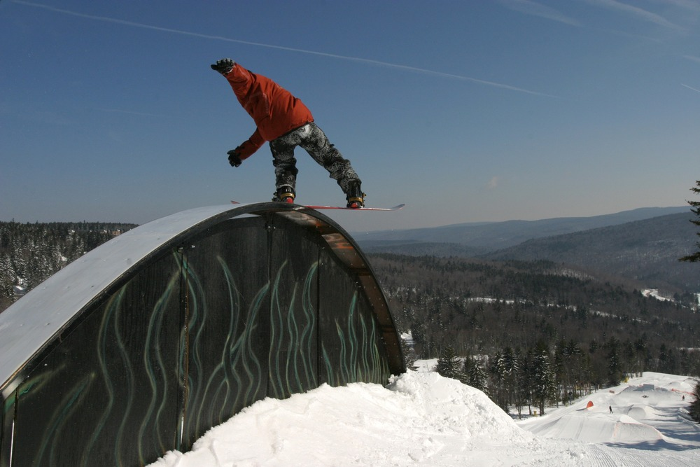 A snowboarder grinds the rail in the terrain park in Snowshoe, West Virginia
