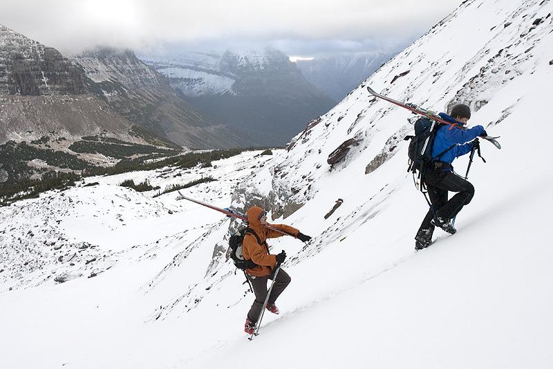 Skiers hike up a steep slope in Glacier National Park. Photo Courtesy GlacierWorld.com